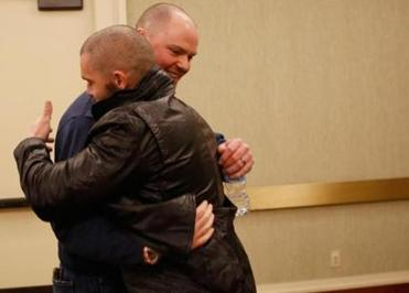 Red Sox ace Jon Lester (rear) hugged teammate Jonny Gomes during Thursday's events at the Copley.